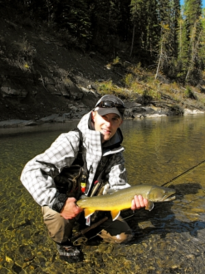 Tim Tchir with a hefty bull trout caught on the streamer
